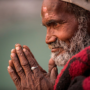 A baba prays on the banks of the Ganges River at Rishikesh, Uttarakhand, India.