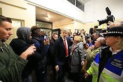 20 February 2017 - The FA Cup - (5th Round) - Sutton United v Arsenal - Arsene Wenger manager of Arsenal makes his way through the media pack inside the lobby at Gander Green Lane - Photo: Marc Atkins / Offside.