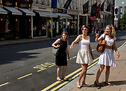 Women out shopping on Bond Street, central London. A shoppers dream.