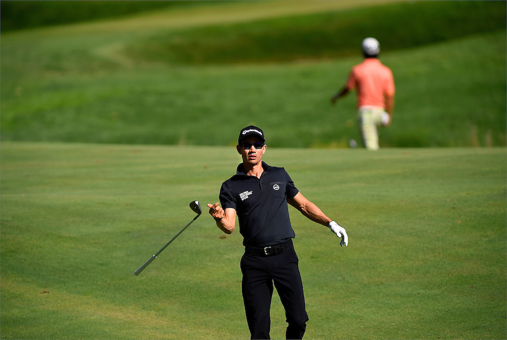 Camilo Villegas tosses his club back to his caddie after sinking his second shot on the tenth hole during the second round of The Barclays Championship held at Plainfield Country Club in Edison, New Jersey on August 28.
