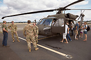 Guests looking at National Guard helicopters at Warbirds Over the West.