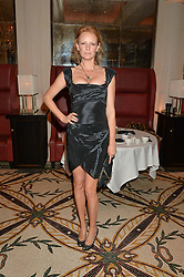 OLIVIA INGE at a dinner hosted by Amy Molyneaux and Percy Parker of fashion label PPQ to celebrate the PPQ AW 2015 collection 'Persephone' held at Braserie Chavot, 41 Conduit Street, London on 22nd February 2015.