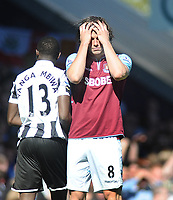 Football - 2012 / 2013 Premier League - West Ham United vs. Newcastle United<br /> <br /> Andy Carroll - West ham holds his hands to his head after his shot went just wide