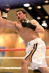 Mar. 6, 2007; South Bend, IN, USA; Former Notre Dame Fighting Irish football player Tom Zbikowski (white trunks) fights Ryan St. Germain (not shown) in an exhibition bout at the Century Center in South Bend, Indiana. Mandatory Credit: Matt Cashore-US PRESSWIRE