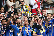 Captain Barry Fuller lifting the play off final trophy alongside Andy Barcham, Callum Kennedy, Jake Reeves and Paul Robinson following a 2-0 win in  the Sky Bet League 2 play off final match between AFC Wimbledon and Plymouth Argyle at Wembley Stadium, London, England on 30 May 2016.
