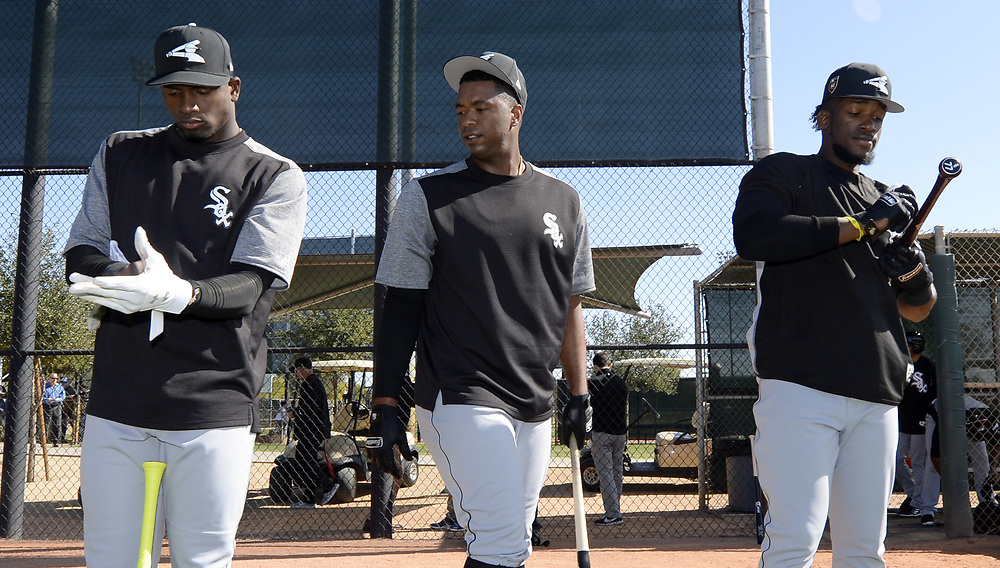 GLENDALE, ARIZONA - FEBRUARY 20:  Left to right, Luis Robert, Eloy Jimenez and Luis Basabe of the Chicago White Sox prepare to hit during a spring training workout February 20, 2018 at Camelback Ranch in Glendale Arizona.  (Photo by Ron Vesely)  Subject:   Luis Robert; Eloy Jimenez; Luis Basabe
