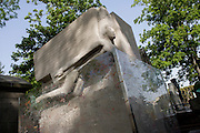 "Celebrated grave for the Dublin-born playright and known homosexual, Oscar Wilde in the Pere Lachaise cemetery, Paris. 19th century Irish playwright and wit Oscar Wilde once quipped: ""One can survive anything these days, except death, and live down anything except a good reputation."" He died in Paris at only 46, impoverished and broken down from years of being villified by Victorian society. He was buried at Père Lachaise with a modest tomb, but a memorial was later erected. Today the monument is covered in lipstick marks left by ardent visitors.."