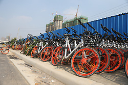 July 6, 2018 - Zhengzhou, Zhengzhou, China - Zhengzhou, CHINA-Numerous abandoned shared bicycles can be seen in Zhengzhou, central China's Henan Province. (Credit Image: © SIPA Asia via ZUMA Wire)