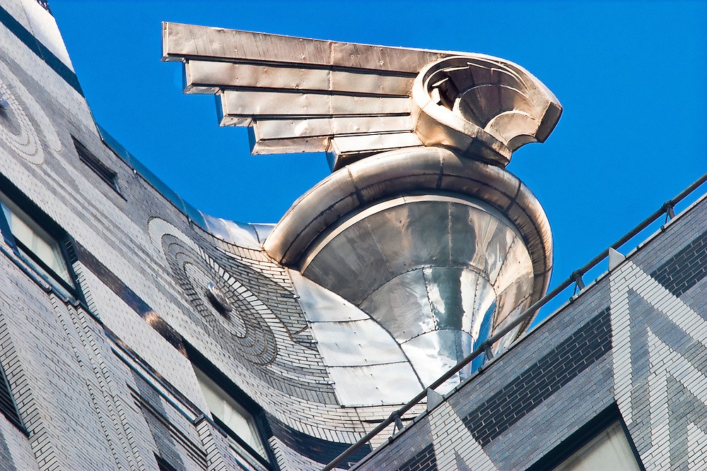 Constructed in 1930, giant, winged. Art Deco metal ornaments adorning the Chrysler Building's 31st floor were patterned after the radiator caps on 1929 Chrysler cars.