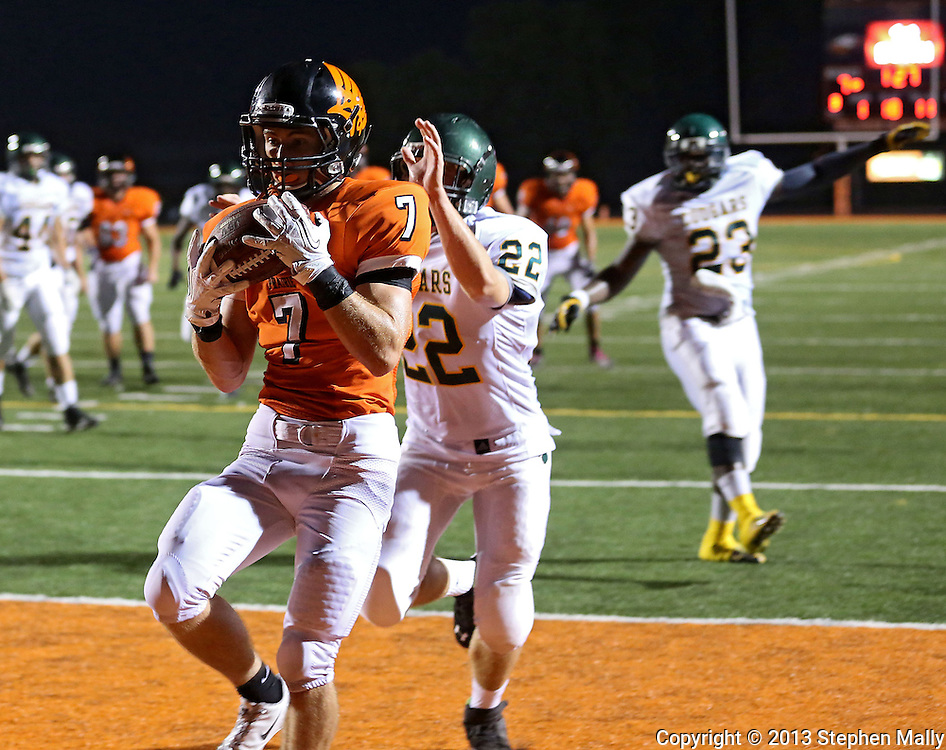 Prairie's Mitchell Dellamuth (7) pulls in a touchdown catch in front of Kennedy's Jay Blank (22) during their game at John Wall Memorial Stadium at Prairie High School in Cedar Rapids on Friday, September 6, 2013.