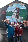 Guided Taxi tour with William III mural. A staunch unionist area. Shankhill Road estate, Belfast. It is a staunch unionist area, fiercely pro-Britain. Their representatives, the Democratic Unionist Party, founded by Ian Paisley in 1971, are presently in parliament in collusion with the conservative party, looking for a hard Brexit with a border between Northern Ireland and the South. The ten DUP votes gives the conservative party its majority in government. This is nothing new. During the 'Troubles' three decades of bloodshed, with Catholic Irish Republican Nationalists seeking to unit Ireland, the pro-British Protestant loyalists wanted to remain part of the United Kingdom