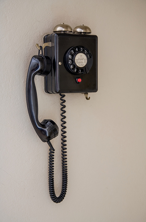 Old telephone in the common area of a country inn in the Swiss Alps
