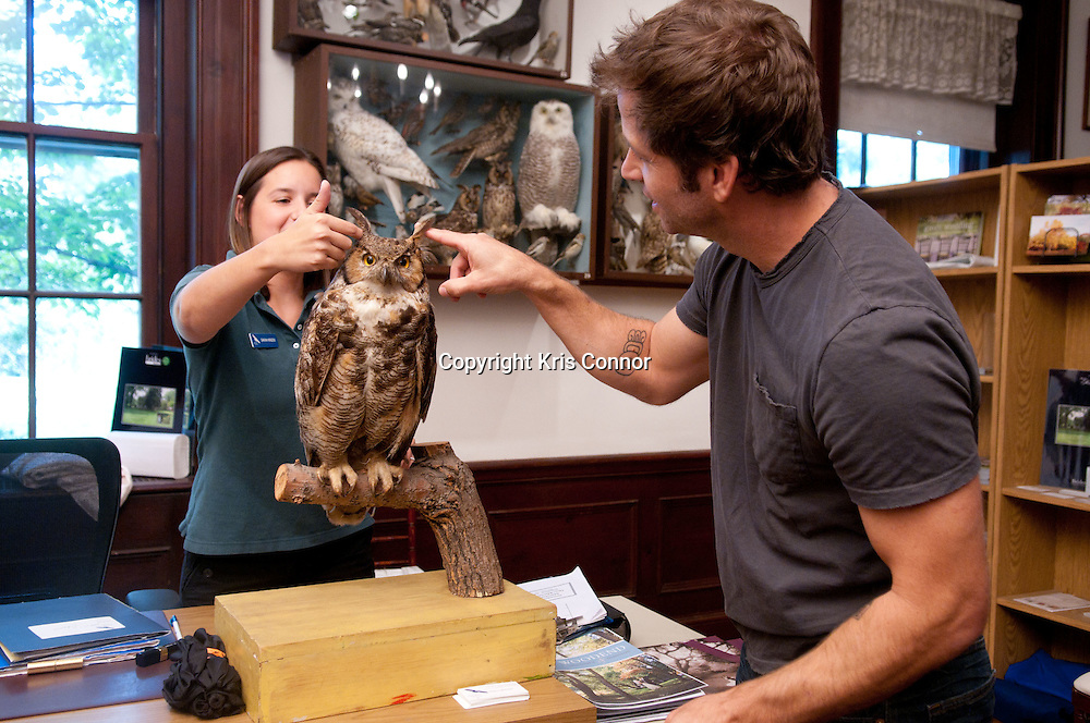 """Director Zack Snyder pets a replica of an owl during a visit to promote the new Warner Brothers' movie """"Legend of the Guardians: The Owls of Ga'Hoole,"""" at the Audubon Naturalist Society Wildlife Sanctury in Chevy Chase, Md on September 14, 2010. Photo by Kris Connor"""