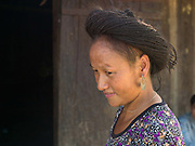 Yai, a Hmong woman, wearing a hairpiece made from her own hair collected from her hairbrush over many years in the Hmong village of Ban Pom Khor, Houaphan province, Lao PDR