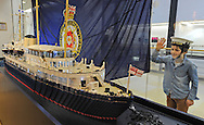 JP License<br /> The Royal Yacht Britannia.<br /> <br />  A LEGO replica model of The Queen's former floating palace, The Royal Yacht Britannia, was unveiled today at the five star attraction's Visitor Centre in Ocean Terminal.<br />  <br /> Created using 40,000 LEGO bricks, and measuring over 11 feet in length, the magnificent 1:37 scale model is due to go on display to the public at Britannia's Visitor Centre later this week.<br />  <br /> <br /> 8 year old Henry Hussain has a close look at the lego model.<br /> <br /> <br /> <br /> <br /> <br />  Neil Hanna Photography<br /> www.neilhannaphotography.co.uk<br /> 07702 246823