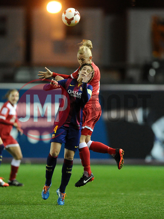 Bristol Academy Womens' Sophie Ingle battles for the high ball with FC Barcelona's Marta Unzue  - Photo mandatory by-line: Joe Meredith/JMP - Mobile: 07966 386802 - 13/11/2014 - SPORT - Football - Bristol - Ashton Gate - Bristol Academy Womens FC v FC Barcelona - Women's Champions League