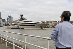 © Licensed to London News Pictures. 28/09/2016. LONDON, UK.  Superyacht 'Kismet' arrives and moors at Butlers Wharf on the River Thames near Tower Bridge in London and is seen during sunny autumn weather. Kismet is 308 feet long and is believed to be owned by Pakistani-American billionaire Shahid Khan, but can be chartered for an estimated £1m per week. Kismet has 6 staterooms, with the master bedroom having its own private deck with jacuzzi and helipad.  Photo credit: Vickie Flores/LNP