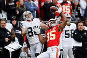Kansas City Chiefs cornerback Charvarius Ward (35) breaks up a pass intended for Oakland Raiders wide receiver Jordy Nelson (82) during the first half of an NFL football game in Kansas City, Mo., Sunday, Dec. 30, 2018.  (AP Photo/Colin E. Braley)