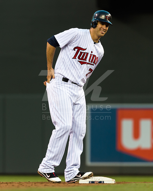 Minnesota Twins Joe Mauer smiles after hitting a double against the Los Angeles Angels on May 8, 2012 at Target Field in Minneapolis, Minnesota.  The Twins defeated the Angels 5 to 0. © 2012 Ben Krause