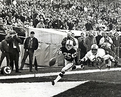 """Oakland Raiders Fred Biletnikoff tries for pass just beyond his reach, Houston""""s Miller Farr behind.<br />(1967 photo /Ron Riesterer/photoshelter)"""