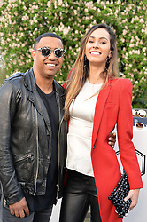 CARLOS VINASCO and ALINE LIMA at a party to launch the Taylor Morris Explorer Collection held at the Serpentine Lido, Hyde Park, London on 11th May 2016.