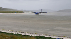 Barra Airport is a short-runway airport situated in the wide shallow bay of Traigh Mhòr at the north tip of the island of Barra in the Outer Hebrides, Scotland. Barra is now the only beach airport anywhere in the world to be used for scheduled airline services. Loganair Twin Otter approaching terminal building. (c) Stephen Lawson   Edinburgh Elite media
