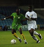 Photo: Tony Oudot.<br /> Ghana v Senegal. International Friendly. 21/08/2007.<br /> Modou Sougou of Senegal moves away fromSulley Mantari of Ghana