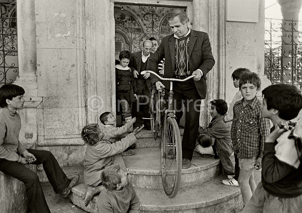 Young boys begging from worshipers leaving the Et'hem Bey mosque located in the center of the Albanian capital Tirana. In January 1991, despite opposition among communist authorities, ten thousand people entered the mosque. After the 27 year ban on religious worship this event became the onset of the fall of communism in Albania.