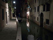 A small, empty Venice canal at night