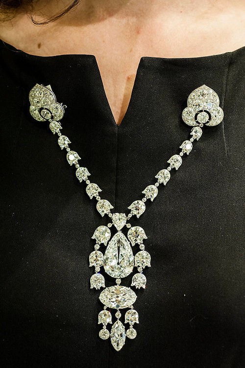 Christie's show off major pieces to be autioned in their Magnificent Jewels sale in Geneva. These include: the Blue - the largest flawless vivid blue diamond in the world, estimate $21-25m; a belle epoque corsage  (pictured) - est $7-12m; the Rajah - a brilliant cut diamond of 26.14 carats, est $3-5m; and the Ocean Dream - the largest fancy vivid bluee-green diamond. King Street, London, UK.