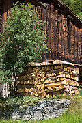 Logpile at typical Swiss wooden chalet in Klosters in Graubunden region, Switzerland