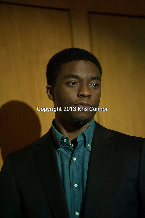 """WASHINGTON, DC - APRIL 15:  Chadwick Boseman speaks during  the Washington DC screening of Warner Bro's film """"42"""" at Smithsonian Museum of American History on April 15th, 2013. Guests included star of the film Chadwick Boseman, John Gray, Carol Melton, and Lonnie Bunch. Photo by Kris Connor/Warner Bros"""