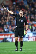 Referee Graham Scott points for a corner. Skybet football league Championship match, Huddersfield Town v Leeds United at the John Smith's Stadium in Huddersfield, Yorks on Saturday 7th November 2015.<br /> pic by Chris Stading, Andrew Orchard sports photography.
