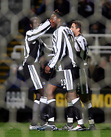 Fotball<br /> UEFA-cup 2004/05<br /> Newcastle v Heerenveen<br /> 24. februar 2005<br /> Foto: Digitalsport<br /> NORWAY ONLY<br /> Newcastle's Shola Ameobi (C), Amdy Faye (L) and Laurent Robert (R) celebrating taking an early lead through an own goal.