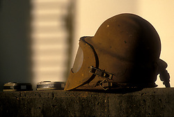 Stock photo of an old welder's visor sitting on a concrete ledge