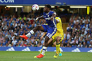 Michy Batshuayi of Chelsea attempts an overhead kick while being marked closely by Peter Hartley of Bristol Rovers. EFL Cup 2nd round match, Chelsea v Bristol Rovers at Stamford Bridge in London on Tuesday 23rd August 2016.<br /> pic by John Patrick Fletcher, Andrew Orchard sports photography.