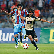 Trabzonspor's Gustavo COLMAN (L) and Benfica's Pablo AIMAR (R) during their UEFA Champions League third qualifying round, second leg, soccer match Trabzonspor between Benfica at the Ataturk Olimpiyat Stadium at İstanbul Turkey on Wednesday, 03 August 2011. Photo by TURKPIX