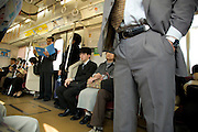 inside a Tokyo train during regular daytime business hours