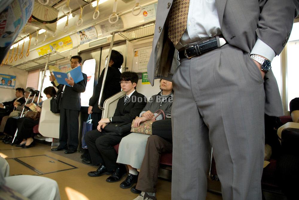 inside a Tokyo train during regular daytime business hours