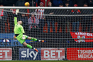 Paul Farman , the goalkeeper of Lincoln City attempts to save a Barnet long range chance. EFL Skybet Football League two match, Barnet v Lincoln City at the Hive in London on Saturday 20th January 2018. <br /> pic by Steffan Bowen, Andrew Orchard sports photography.