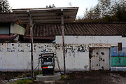 A petrol station in the abandoned village of Tsushima in Fukushima, Japan. Friday May 4th 2012. After the explosions at the Daichi nuclear plant caused by the March 11th 2011 earthquake and tsunami, High levels of radioactive contamination in this village have made it uninhabitable.