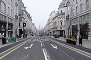 Scene at Lower Regent Street where very few people or vehicles are out and about as the national coronavirus lockdown three continues on 3rd March 2021 in London, United Kingdom. With the roadmap for coming out of the lockdown has been laid out, this nationwide lockdown continues to advise all citizens to follow the message to stay at home, protect the NHS and save lives, and the streets of the capital are quiet and empty of normal numbers of people.