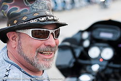 Krazy J of Minneapolis enjoys the warm weather during Daytona Bike Week as snow threatens the midwest. FL, USA. March 11, 2014.  Photography ©2014 Michael Lichter.