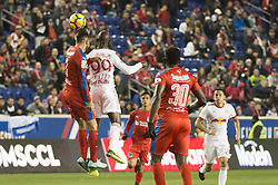 March 1, 2018 - Harrison, New Jersey, United States - Club Deportivo Olimpia Defender NICOLAS DEL GRECCO (3) heads the ball over New York Red Bulls forward BRADLEY WRIGHT-PHILLIPS (99) while Club Deportivo Olimpia Defender JOHNNY PALACIOS (30) looks on during the CONCACAF Champions league match at Red Bull Arena in Harrison, NJ.  NY Red Bulls defeat CD Olimpia 2-0  (Credit Image: © Mark Smith via ZUMA Wire)