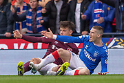 Ryan Kent of Rangers FC & Aaron Hickey of Hearts both protest to the referee during the Betfred Scottish League Cup semi-final match between Rangers and Heart of Midlothian at Hampden Park, Glasgow, United Kingdom on 3 November 2019.