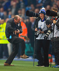 A squirel is removed from the pitch ahead of the Carabao Cup, Fourth Round match at the Etihad Stadium, Manchester.