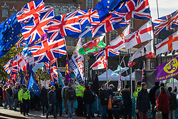 © Licensed to London News Pictures. 28/10/2019. London, UK. Pro- and anti-Brexit protesters wave flags outside Parliament. The EU has granted a flexible extension to the Brexit deadline until 31 January 2020. MPs will vote today on whether to hold a general election in December.  Photo credit: Rob Pinney/LNP