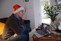 Only contact with elderly parent in care home at Christmas is via Zoom. Christmas Day 2020 UK. Posed by model