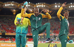 Gold medallist in the Men's Long Jump Final South Africa's Luvo Manyonga (centre) with silver medallist Australia's Henry Frayne (left) and bronze medallist South Africa's Ruswahl Samaai at the Carrara Stadium during day seven of the 2018 Commonwealth Games in the Gold Coast, Australia. PRESS ASSOCIATION Photo. Picture date: Wednesday April 11, 2018. See PA story COMMONWEALTH Athletics. Photo credit should read: Danny Lawson/PA Wire. RESTRICTIONS: Editorial use only. No commercial use. No video emulation.