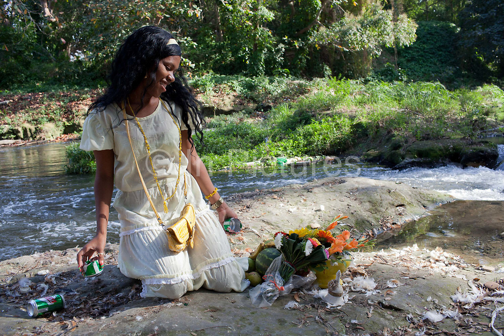 Bosque Almendares in Havana is an important place for Santeria ceremonies where ahderents make offerings to the Orishas. Santeria is a syncretic religion practiced in Cuba, it is a mixture of Yoruba tribal practices brought from Nigeria during Colonial times, and traditional Catholic beliefs. During this time, the slaves used the images of saints to cover up their worship of the Orishas (spirits).